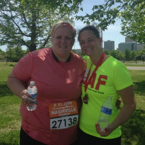 Advance Financial CEO, Tina Hodges, helping a runner with leg cramp
