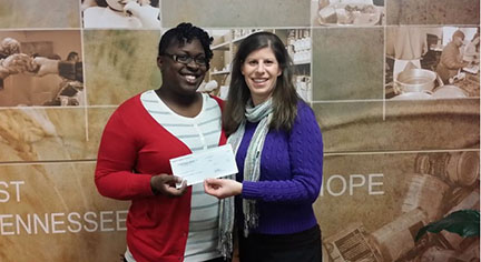 Advance Financial Operations Manager donating check to Second Harvest Food Bank