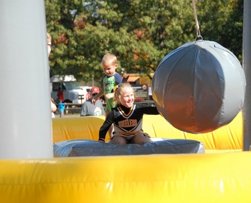 Advance Financial 20th Anniversary Event- Kids playing with inflatable balls